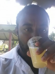 Me drinking fresh sugar cane juice, courtesy of the tourists :)